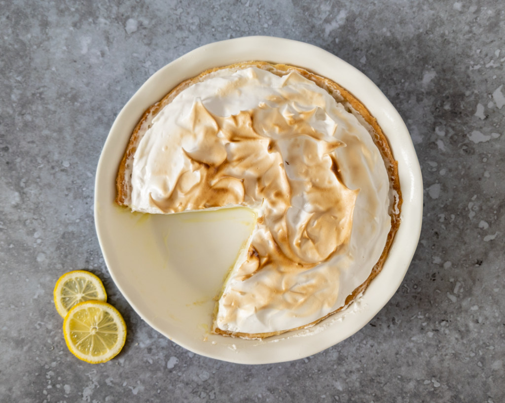 A slice taken out of the best vegan lemon meringue pie.